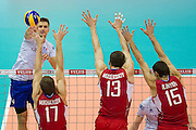 (L) Antonin Rouzier from France attacks during the 2013 CEV VELUX Volleyball European Championship match between Russia v France at Ergo Arena in Gdansk on September 25, 2013.<br /> <br /> Poland, Gdansk, September 25, 2013<br /> <br /> Picture also available in RAW (NEF) or TIFF format on special request.<br /> <br /> For editorial use only. Any commercial or promotional use requires permission.<br /> <br /> Mandatory credit:<br /> Photo by &copy; Adam Nurkiewicz / Mediasport