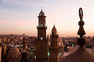 Egypt. Cairo elevated view.  - the Qalawun complex. minarets of An Nasr  and qalawun the old islamic city.,view from the minaret of the madrasa of As Zahir BARQUQ  mosque  in Al Mu'izz street .Cairo