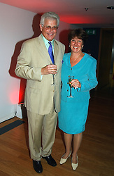 CHRISTOPHER SPENCE Chairman of the Diana, Princess of Wales Memorial Fund and his wife NANCY SPENCE at a party to celebrate the UK launch of Diana:The Portrait, the authorised book about the late Princess Of Wales's life and work, held at the National Portrait Gallery, London on 1st September 2004.  The book was commissioned by The Diana, Princess of Wales Memorial Fund and writen by Ros Coward.