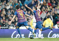 10.12.2011, Santiago Bernabeu Stadion, Madrid, ESP, Primera Division, Real Madrid vs FC Barcelona, 15. Spieltag, im Bild Barcelona's Xavi Hernandez celebrates with Cesc Fabregas // during the football match of spanish 'primera divison' league, 15th round, between Real Madrid and FC Barcelona at Santiago Bernabeu stadium, Madrid, Spain on 2011/12/10. EXPA Pictures © 2011, PhotoCredit: EXPA/ Alterphotos/ Alvaro Hernandez..***** ATTENTION - OUT OF ESP and SUI *****