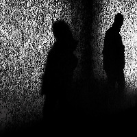 Anonymous silhouette of a man with a shadow on a wall