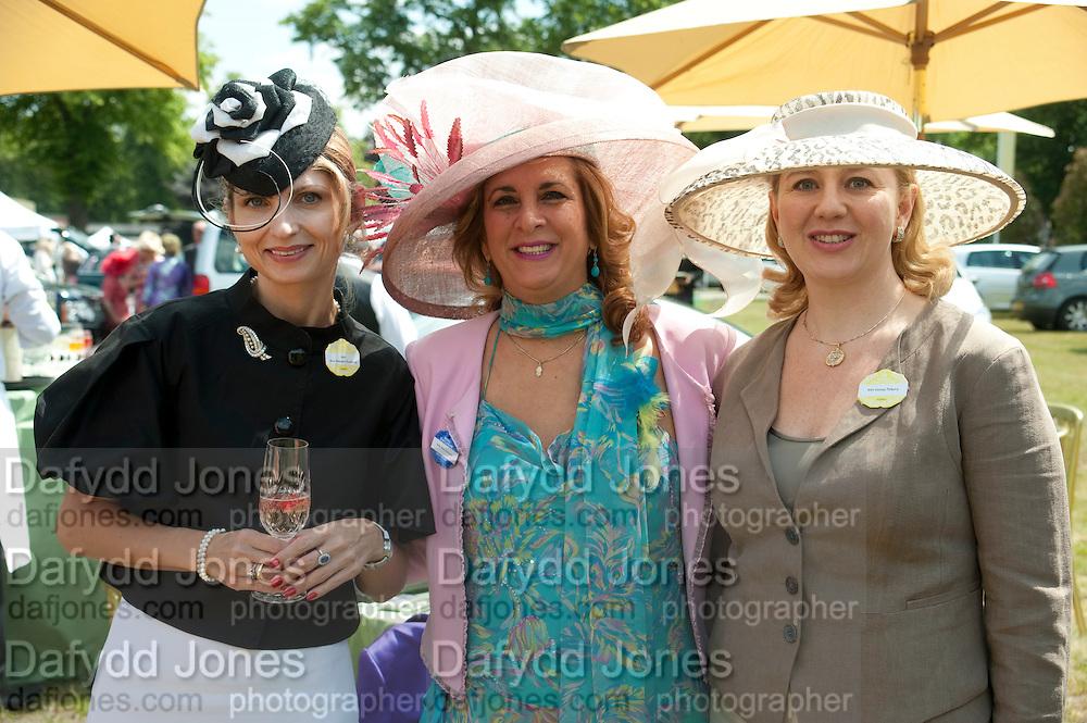 MRS. AISTE  ANUSAITE- DAUBARAS; MISS NORA SEROUSSI; MRS. GEORGE PISKOVA, , Lunch part hosted by Liz Brewer and Mrs. George Piskova in No; 1 car-park. . Royal Ascot. Tuesday. 14 June 2011. <br /> <br />  , -DO NOT ARCHIVE-© Copyright Photograph by Dafydd Jones. 248 Clapham Rd. London SW9 0PZ. Tel 0207 820 0771. www.dafjones.com.