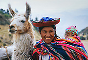 Peruvian mother with child and llama,  Peru, South America RESERVED USE - NOT FOR DOWNLOAD -  FOR USE CONTACT TIM GRAHAM
