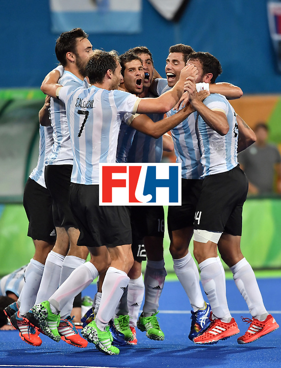 Argentina's players celebrate their victory at the end of the men's Gold medal field hockey Belgium vs Argentina match of the Rio 2016 Olympics Games at the Olympic Hockey Centre in Rio de Janeiro on August 18, 2016. / AFP / Pascal GUYOT        (Photo credit should read PASCAL GUYOT/AFP/Getty Images)