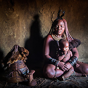 Himba woman in her house near Kamanjab
