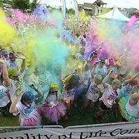 Runners get coated in multi colored starch before this year's Color Vibe Run gets underway in sowntown Tupelo Saturday morning. Some of the proceeds wne to the Family Resource Center in Tupelo.