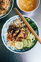 Bun thit nuong--rice noodles with grilled pork and fresh herbs--in Hue, Vietnam.