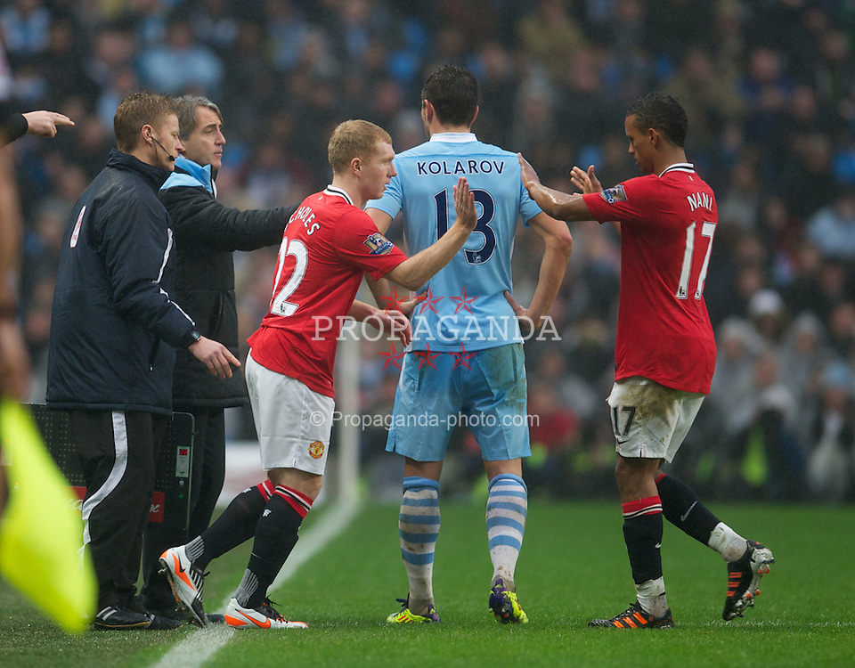 MANCHESTER, ENGLAND - Sunday, January 8, 2012: Manchester United's Paul Scholes prepares to come on as s substitute against Manchester City after returning from retirement during the FA Cup 3rd Round match at the City of Manchester Stadium. (Pic by David Rawcliffe/Propaganda)