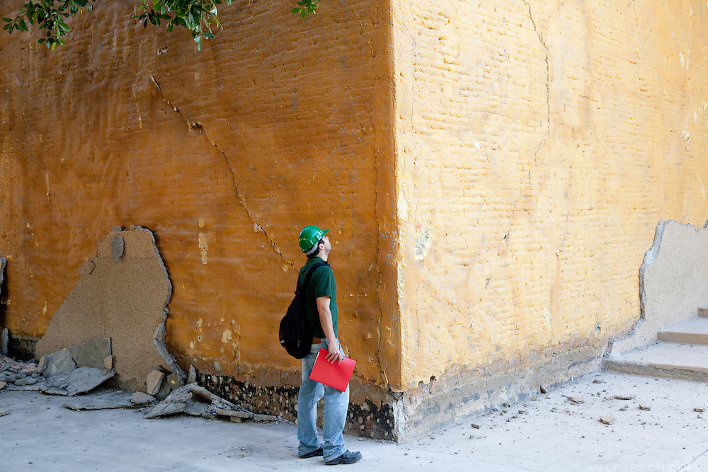 Juan Murcia inspects a damaged wall on the campus of the Universidad Autónoma de Baja California. A group of researchers led by Dr. Shing, Vice Chair of the Department of Structural Engineering at the University of California, San Diego, inspected the earthquake damage in Mexicali, Mexico, April 7, 2010. A 7.2 magnitude earthquake in Baja California on Easter Sunday was felt as far away as Los Angeles.