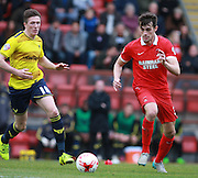 Leyton Orient striker John Marquis beats Oxford midfielder John Lundstram to the ball during the Sky Bet League 2 match between Leyton Orient and Oxford United at the Matchroom Stadium, London, England on 17 October 2015. Photo by Bennett Dean.