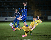 Gavin Rothery (Guiseley) clears the ball just in time during the Conference Premier League match between FC Halifax Town and Guiseley at the Shay, Halifax, United Kingdom on 5 December 2015. Photo by Mark P Doherty.