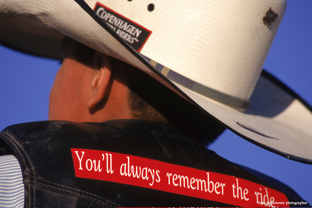 "At the Dilkon Buckaroo Days Rodeo, a young bull rider wears a ""You'll always remember the ride"" sticker on the back of his vest. In the heart of the Navajo Nation, cowboys sport the standard uniform of rodeo riders everywhere: Western hats, blue jeans and boots. But the hundreds of spectators in the stands are a cross section of Navajo people. As the announcer narrates the action, he switches effortlessly between English and rapid Navajo."
