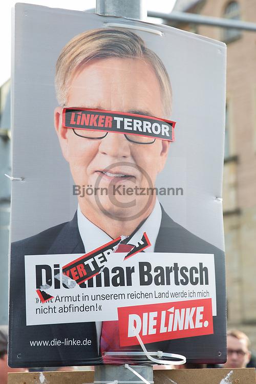 Wurzen, Germany - 02.09.2017<br /> <br /> Right stickers on an election poster of the left party.<br /> <br /> Antifaschistische Demonstration gegen Neonazis und Rassismus mit etwa 400 Teilnehmern in der saechsischen Kleinstadt Wurzen. Rechte Aufkleber auf einem Wahlplakat der Linkspartei. Weil eine Teilnehmerin der Demonstratin Aufkleber von Linkspartei Plakaten entfernte wurde sie von der Polizei kontrolliert.<br /> <br /> Photo: Bjoern Kietzmann