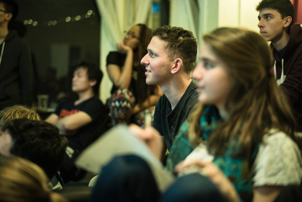 SAN FRANCISCO, CA – JANUARY 13, 2016: A group of Minerva college students listen to a presentation from a peer in the San Francisco residence hall.<br /> <br /> Minerva is a unique 21st century university built on a global four-year education model. It is deliberately designed to enhance intellectual growth and prepare students for success in today's rapidly changing global context. Founded in 2014, the university targets the developing world's rising middle class who seek an elite American education. With a 2.8% acceptance rate among the founding class, Minerva is the most selective undergraduate program in U.S. history.