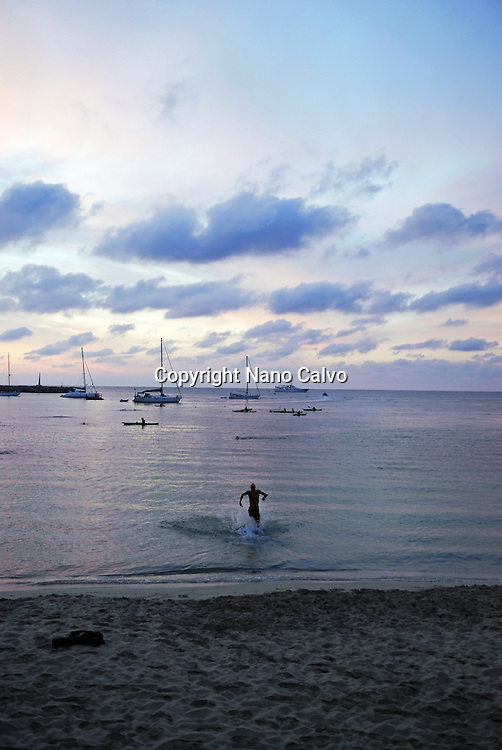Solitary triathlete enters the sea