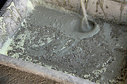 mixing a chemical substance and cement to make a waterproofing paste