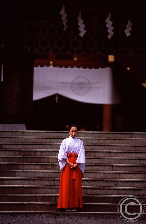 A female shrine attendant at Hokkadio's largest shrine - Hokkaido Jingu in Sapporo, Hokkaido, Japan