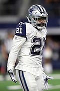 Dallas Cowboys running back Ezekiel Elliott (21) shrugs his shoulders after running for a late fourth quarter gain of 21 yards and a first down at the New Orleans Saints 24 yard line during the NFL week 13 regular season football game against the New Orleans Saints on Thursday, Nov. 29, 2018 in Arlington, Tex. The Cowboys won the game 13-10. (©Paul Anthony Spinelli)