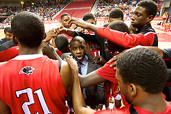 PIAA District 12 Public League Basketball Championships Final, Liacouras Center, Philadelphia, PA, USA - February 24, 2013; Head Coach Andre Noble surrounded by the players during a timeout.