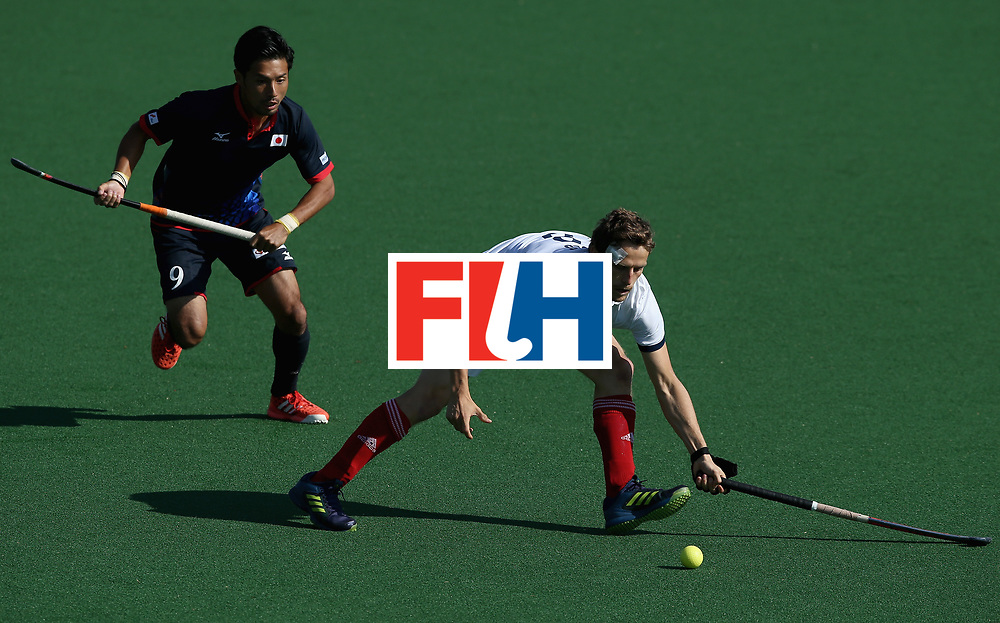 JOHANNESBURG, SOUTH AFRICA - JULY 13:  Jean-Baptiste Forgues of France and Kenta Tanaka of Japan battle for possession  during day 3 of the FIH Hockey World League Semi Finals Pool A match between Japan and France at Wits University on July 13, 2017 in Johannesburg, South Africa.  (Photo by Jan Kruger/Getty Images for FIH)