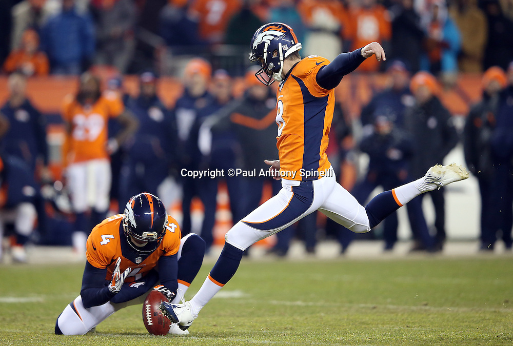 Denver Broncos punter Britton Colquitt (4) holds while Denver Broncos kicker Brandon McManus (8) misses a potential game winning field goal at the end of regulation play, forcing overtime, during the 2015 NFL week 16 regular season football game against the Cincinnati Bengals on Monday, Dec. 28, 2015 in Denver. The Broncos won the game in overtime 20-17. (©Paul Anthony Spinelli)