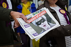 "© Licensed to London News Pictures. 20/05/2017. LONDON, UK.  UKIP supporters hold leaflets showing a picture of Theresa May, captioned ""Beware of scams"" as they campaign in Elm Park with UKIP leader, Paul Nuttall and UKIP candidate for Dagenham and Rainham, Peter Harris. All political parties continue to campaign across the UK ahead of the general election taking place on 8th June. Photo credit: Vickie Flores/LNP"