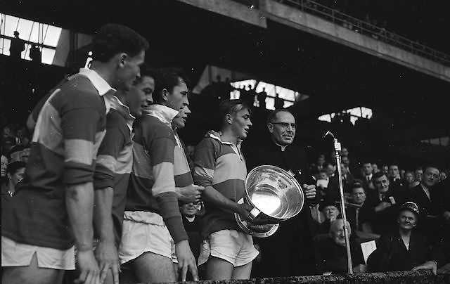All Ireland Minor Football Final Kerry v. Westmeath, Croke Park..T. Hanlon, Capt. of the victorious Team calls for three cheers after recieving the cup from Most Reverend. Dr. Morris, Archbishop of Cashel (right) .22.09.1963