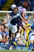 Maikel Kieftenbeld challenges for a header with Nick Blackman during the Sky Bet Championship match between Birmingham City and Reading at St Andrews, Birmingham, England on 8 August 2015. Photo by Alan Franklin.