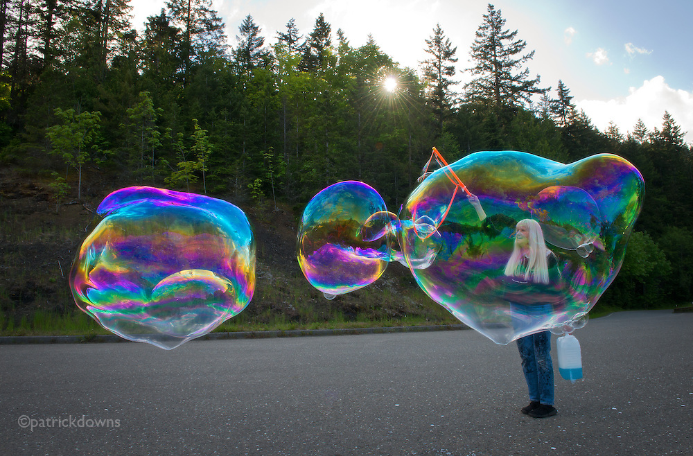 """The """"Bubble Lady of Sequim"""" works her bubble magic along the highway to Hurricane Ridge, on a warm, sunny spring day."""