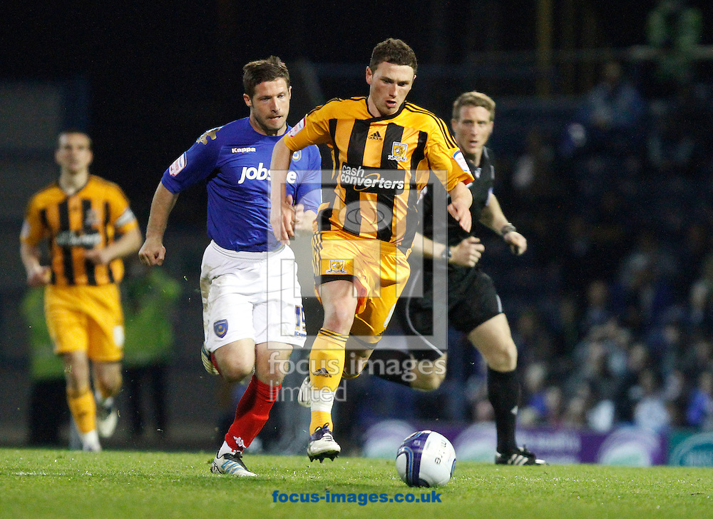 Picture by Daniel Chesterton/Focus Images Ltd. 07966 018899.27/03/12.Corry Evans of Hull City and David Norris of Portsmouth during the Npower Championship match at Fratton Park stadium, Portsmouth.