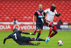 Moussa Sissoko of Newcastle United makes a slide tackle against Jamal Campbell-Ryce of Sheffield United - Mandatory by-line: Matt McNulty/JMP - 26/07/2015 - SPORT - FOOTBALL - Sheffield,England - Bramall Lane - Sheffield United v Newcastle United - Pre-Season Friendly
