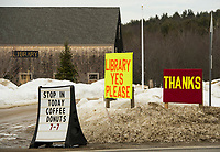 "Signs for ""support and thanks"" for the Gilmanton Library on election day with the polls open at Gilmanton Elementary School on Tuesday afternoon.  (Karen Bobotas/for the Laconia Daily Sun)"
