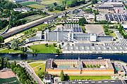 Nederland, Zuid-Holland, Rotterdam, Overschie, 10-06-2015; Van Nelle fabriek, architecten Brinkman en Van der Vlug en icoon van het Nieuwe Bouwen. Industrieel monument en Unesco Werelderfgoed, in gebruik als Ontwerpfabriek, congrescentrum. Penitentiaire Inrichting De Schie (Gevangenis Overschie) in de voorgrond.<br /> <br /> The Van Nelle Factory. Industrial property, historic monument and UNESCO World Heritage site.<br /> luchtfoto (toeslag op standard tarieven);<br /> aerial photo (additional fee required);<br /> copyright foto/photo Siebe Swart