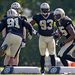 Jul 29, 2013; Metairie, LA, USA; New Orleans Saints defensive end Martez Wilson (95) and linebacker Will Smith (91) run a linebackers drill during a morning training camp practice at the team facility.  Mandatory Credit: Derick E. Hingle-USA TODAY Sports