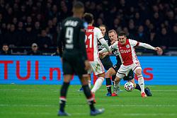 Dusan Tadic #10 of Ajax and Dani de Wit #10 of AZ Alkmaar in action during the Dutch Eredivisie match round 25 between Ajax Amsterdam and AZ Alkmaar at the Johan Cruijff Arena on March 01, 2020 in Amsterdam, Netherlands