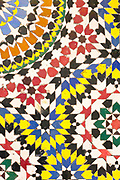 Close up of intricate mosaic zelij tiling work inside the Fez (Fes) el Bali historic Medina, Morocco, 2015-12-16.<br />
