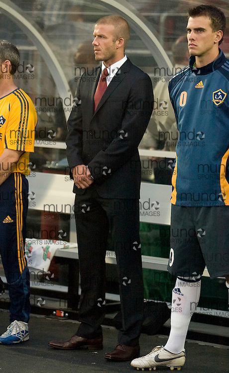 David Beckham sits on the bench as he and his Los Angeles Galaxy teammates take the field against the Toronto FC  04 August, 2007.  .AFP PHOTO/GEOFF ROBINS