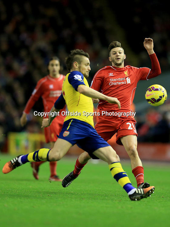 21 December 2014 - Barclays Premier League - Liverpool v Arsenal - Adam Lallana of Liverpool in action with Mathieu Debuchy of Arsenal - Photo: Marc Atkins / Offside.