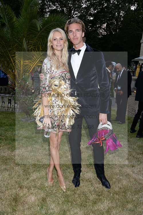 POPPY DELEVINGNE and JAMES COOK at The Animal Ball in aid of The Elephant Family held at Lancaster House, London on 9th July 2013.