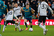 Hull City defender Callum Elder wins the ball during the EFL Sky Bet Championship match between Derby County and Hull City at the Pride Park, Derby, England on 18 January 2020.