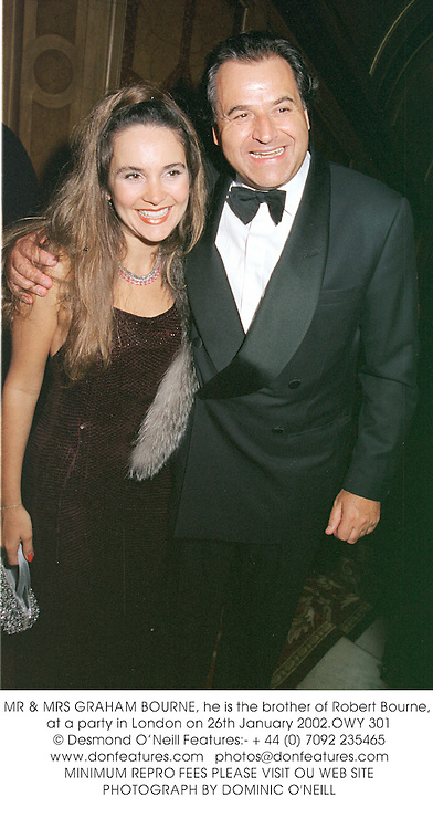 MR & MRS GRAHAM BOURNE, he is the brother of Robert Bourne, at a party in London on 26th January 2002.	OWY 301
