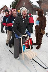 Women Standing on Kicksled in Kolkja Kelk, Tartu County, Estonia