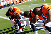DENVER, CO - OCTOBER 30: Denver Broncos players form a line to pray before the game against the Detroit Lions at Sports Authority Field at Mile High on October 30, 2011 in Denver, Colorado. The Lions won 45-10. (Photo by Joe Robbins)