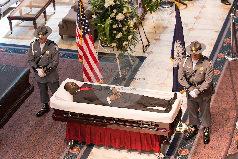 Police honor guard stand by the body of slain State Senator Clementa Pinckney in state in the State Capitol during public visitation June 24, 2015 in Columbia, South Carolina. Pinckney is one of the nine people killed in last weeks Charleston church massacre.