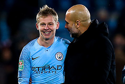 Manchester City manager Pep Guardiola celebrates with Oleksandr Zinchenko of Manchester City after their side's win over Leicester City - Mandatory by-line: Robbie Stephenson/JMP - 18/12/2018 - FOOTBALL - King Power Stadium - Leicester, England - Leicester City v Manchester City - Carabao Cup Quarter Finals