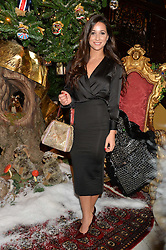 ROXIE NAFOUSI at a party to celebrate the unveiling of the 2014 Claridge's Christmas tree by Dolce & Gabbana at Claridge's, Brook Street, London on 19th November 2014.