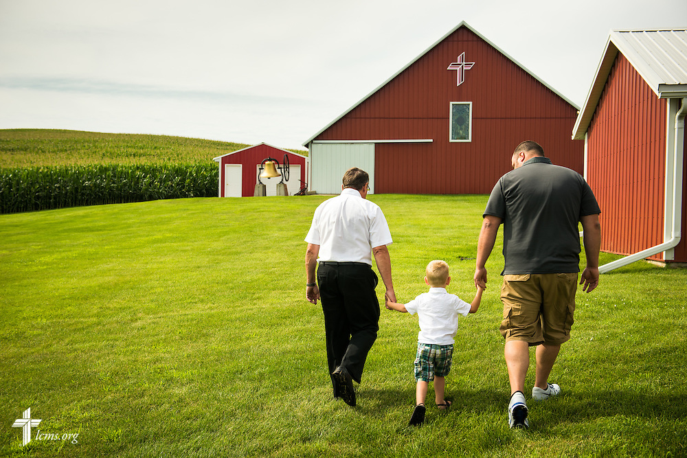 Gary Thies (left) helps lead a young visitor to the sanctuary and mission museum at Mission Central on Sunday, July 19, 2015, in Mapleton, Iowa. LCMS Communications/Erik M. Lunsford