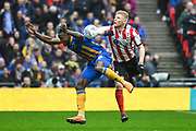 Omar Beckles of Shrewsbury Town (6) and Elliot Whitehouse of Lincoln City (4) battle for the ball during the EFL Trophy Final match between Lincoln City and Shrewsbury Town at Wembley Stadium, London, England on 8 April 2018. Picture by Stephen Wright.