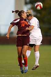 Kelly Quinn fights Virginia Tech's Laurie Beth Puglisi (14) for a header in action at Klockner Stadium in Charlottesville, VA.  The Wahoos beat the Hokies, 2-1.