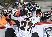 The Calgary Hitmen celebrate after scoring a goal against the Kootenay Ice during the first period at Scotiabank Saddledom in Calgary on Saturday March 22, 2014. (Jenn Pierce/Calgary Herald)